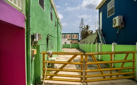 Mop on Yellow Gate Between Green and Blue in Bonaire