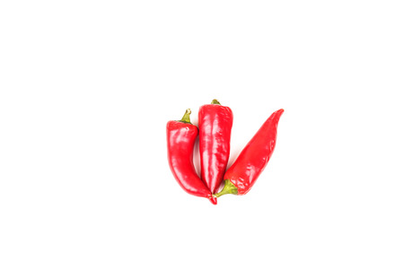 Three red jalapeno peppers on white Imagens
