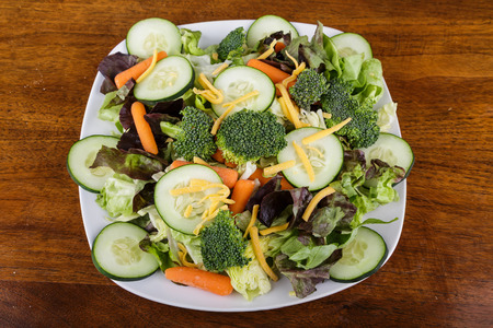 Healthy salad of greens, cucumbers, carrots and brocolli
