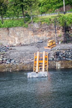 Small Construction Site on Alaskan Coast Фото со стока