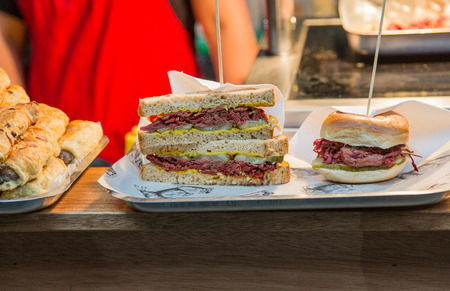 Pastrami and Corned Beef Sandwiches on Lunch Counter with mustard and pickles