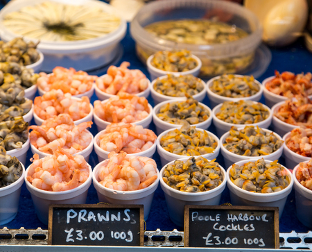 cockles: Prawns and Cockles in Market in London Stock Photo