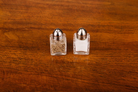 Salt and Pepper Shakers  on Wood Table