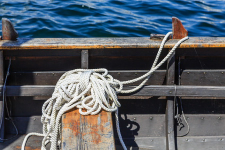 White Rope in Metal Boat by Blue Water