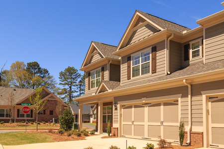 A row of modern townhouses in a new subdivision