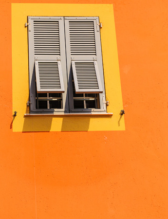 Old Green Shutters on Yellow and Orange Wall Stock fotó