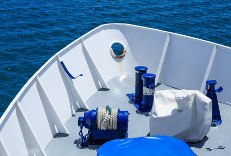 Blue Details in White Hull on Blue Water Imagens