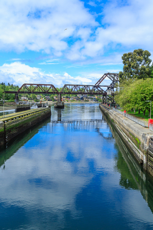 Ballard Locks and Steel Bridge Over Salmon Bay near Seattle Фото со стока