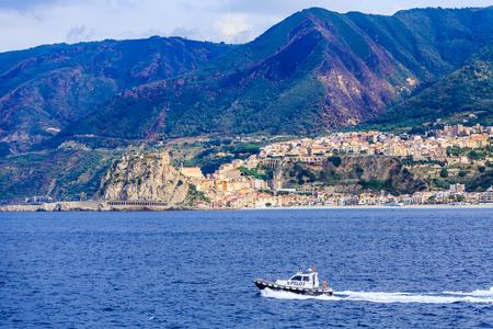 A Pilot Boat Along Mountainous Italian Coast Stock Photo