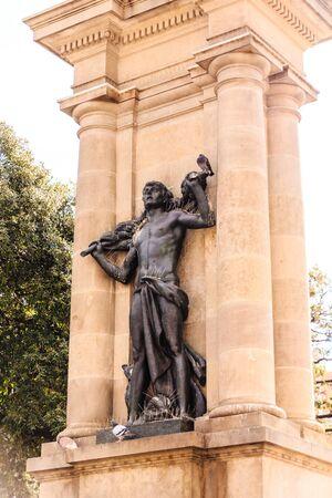 Pigeons on Black Statue