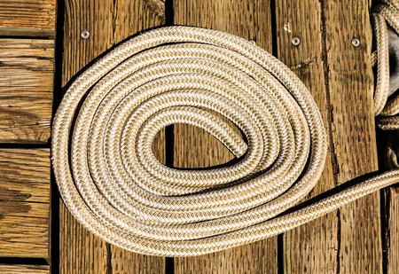 Coil of White Rope on Wood Pier