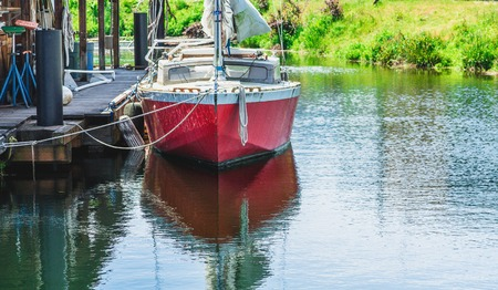 Red Boat Tied to Dock Stock Photo