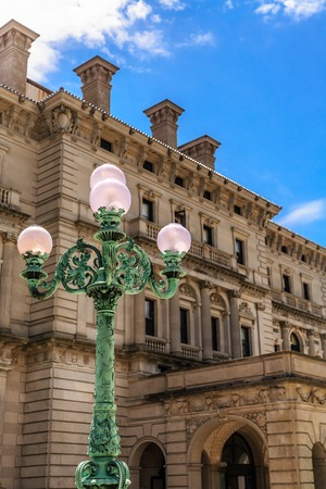 Classic Green Lamp Post by Mansion Stock Photo