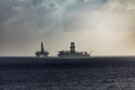 Floating Oil Rigs on Ocean in Sillhouette