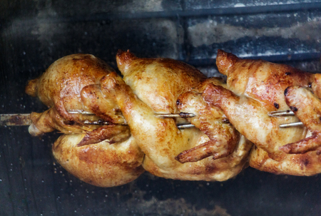 Chickens Roasting on Spit