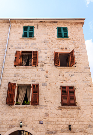 Old Stone Building with Red Shutters Banco de Imagens