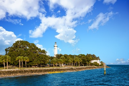 White Lighthouse Rising from Coastal Park