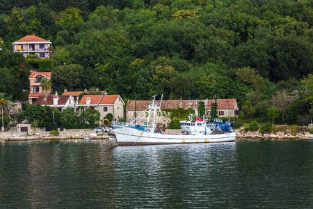 Old Boat Docked on Coast of Montenegro
