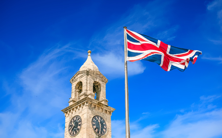 Clock and British Flag Imagens