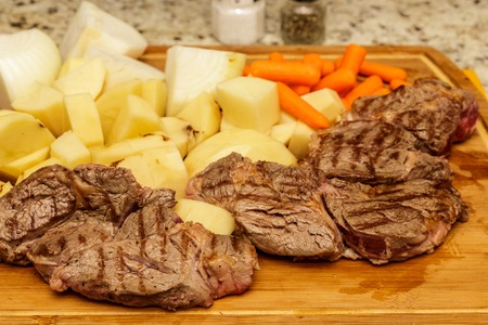 Three Chuck Steaks with Cut Vegetables