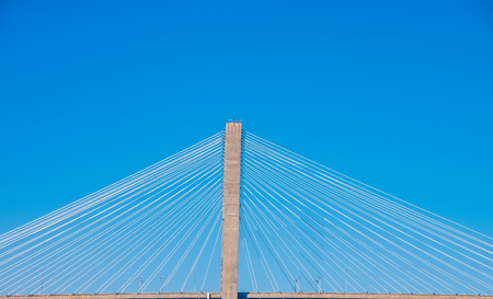 White Cables on Suspension Bridge Against Blue Skies