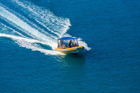 Pleasure Boat with Wake