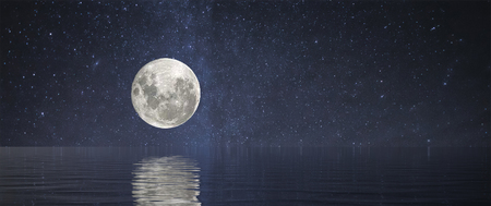 A Full Moon at Sea or over a lake with stars and reflection Stok Fotoğraf