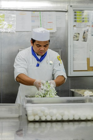 MIAMI, FLORIDA - December 21, 2015: Kitchen staff on cruise ships, including chefs and cooks, work some of the hardest and longest hours as the kitchens are in operation 24 hours a day. 報道画像