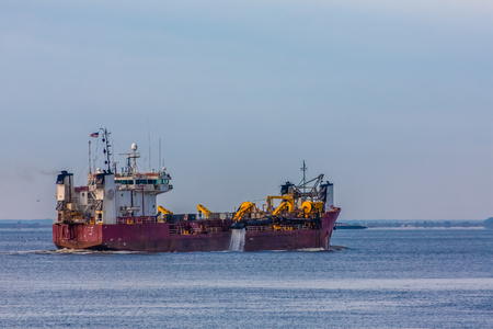 Dredging Ship in Harbor Stock Photo