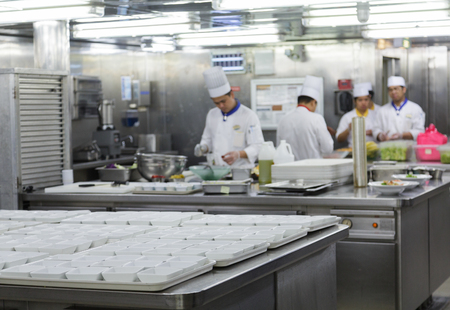 MIAMI, FLORIDA - December 21, 2015: Kitchen staff on cruise ships, including chefs and cooks, work some of the hardest and longest hours as the kitchens are in operation 24 hours a day. 写真素材