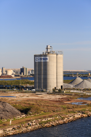 TAMPA, FLORIDA - February 27, 2016: Petroleum refineries are very large industrial complexes that involve many different processing units and facilities such as utility units and storage tanks.
