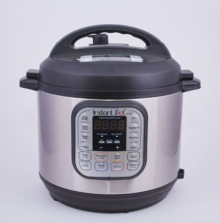 An InstaPot pressure cooker on a white backgrouind