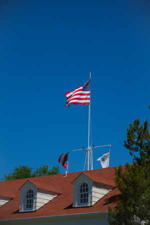 American Flag on Red Roof