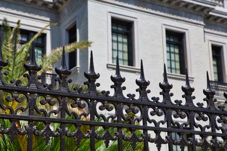 Black Wrought Iron Fence on White Mansion