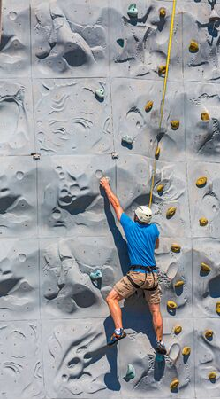 CADIZ, SPAIN - September 27, 2016: Group led pool games, outdoor fun, and innovative activities such as rock climbing and Flow Rider attract new, and old, cruisers every year.