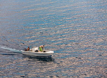 Bailing Out Fishing Boat
