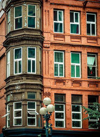 Bay Windows on Red Brick Imagens