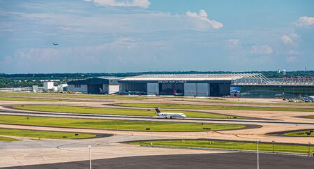ATLANTA, GEORGIA - June 31, 2019: Delta Air Lines, headquartered in Atlanta, operates over 5,000 flights daily in 54 countries. The company began in Macon, Georgia in 1924 as a crop duster.