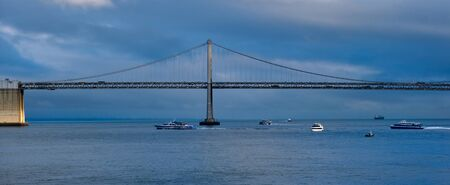 Boats Under Bay Bridge on a Stormy Blue Day