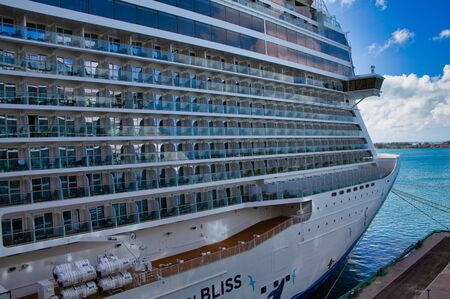 Rows of Curved White Glass Balconies on a Cruise Ship