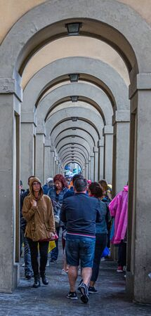 People Through Arches