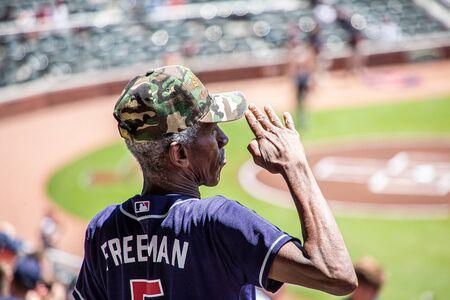 Veteran Saluting During National Anthem