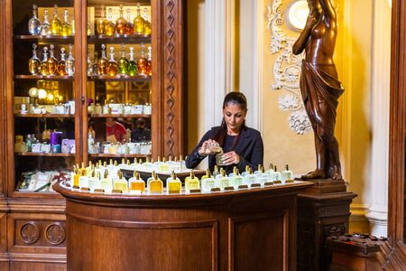 Woman Pouring Perfumes