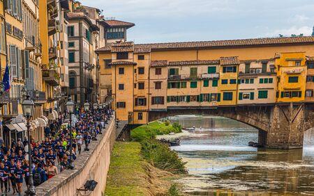 Runners Alongside Ponte Vecchio