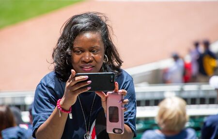 taking Cell Phone Pictures Before a Baseball Game