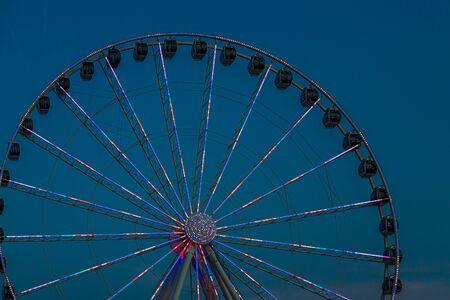 SEATTLE, WASHINGTON - July 4, 2019: The Seattle Great Wheel is a Ferris wheel at Pier 57 in Seattle, Washington. It was the tallest Ferris wheel on the west coast when it opened on June 29, 2012.