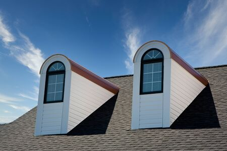 Two dormers on a roof against blue sky Stockfoto