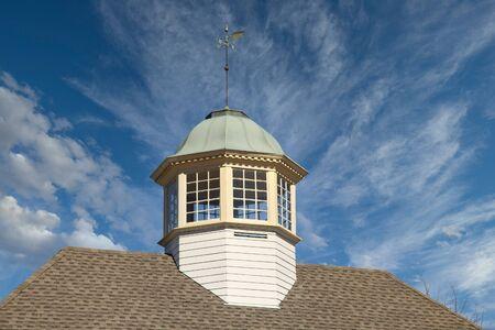Cupola with Weather Vane on Nice Sky