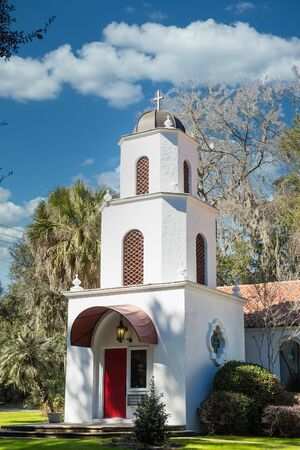 White Church with Red Door Stock Photo