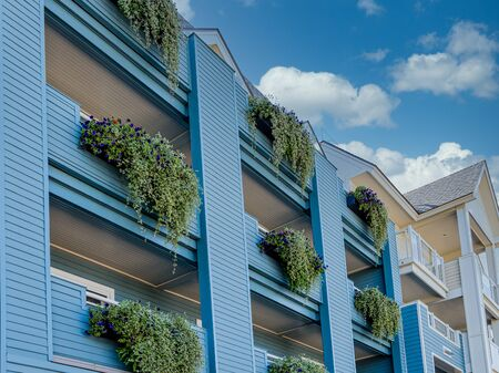 Green Planters on Blue Balconies
